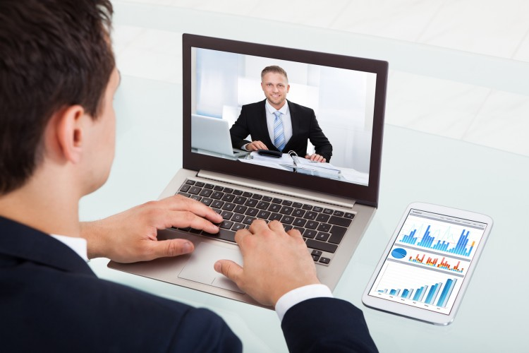 Businessman Video Conferencing On Laptop In Office